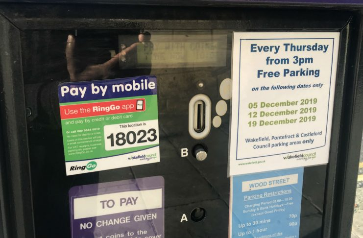Parking meter with free Christmas parking signs